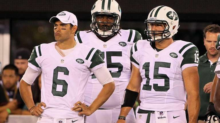 Mark Sanchez, left, and Tim Tebow of the