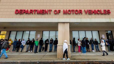 People wait in line outside the DMV in