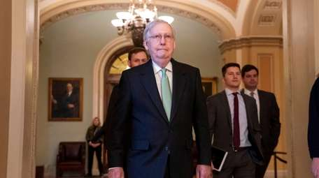 Senate Majority Leader Mitch McConnell (R-Ky.) leaves the