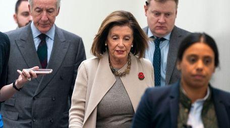 House Speaker Nancy Pelosi leaves a caucus meeting