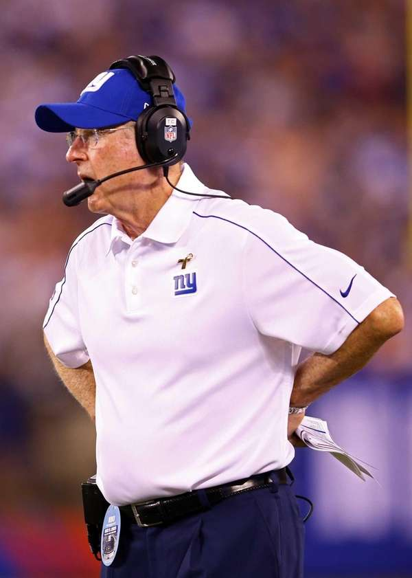Tom Coughlin looks on from the sidelines during