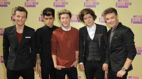Members of the British band One Direction, from