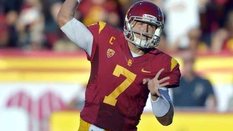 Southern California quarterback Matt Barkley throws a pass
