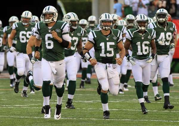 Mark Sanchez leads the Jets onto the field