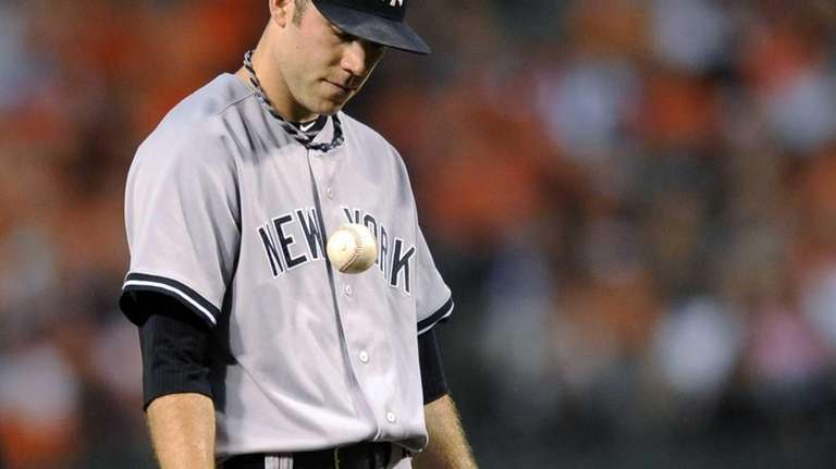 David Phelps reacts after he was called for