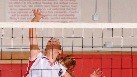 Plainedge High School junior Lisa Maybie, left, attempts