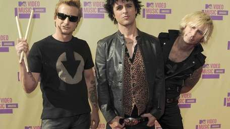 Members of Green Day, from left, Tre Cool,