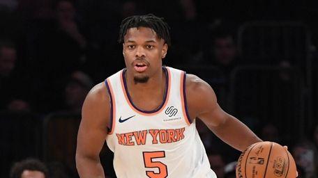 Knicks guard Dennis Smith Jr. dribbles the ball
