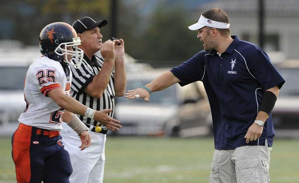 Great Neck North head coach Chris Ceasar gives