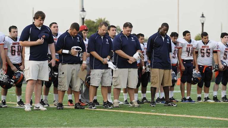 Great Neck North coaches and athletes observe a