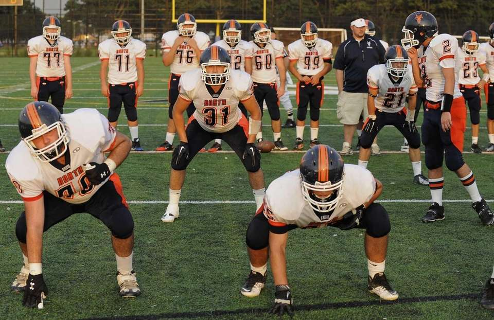 Great Neck North's Oliver Elihu, center, runs a