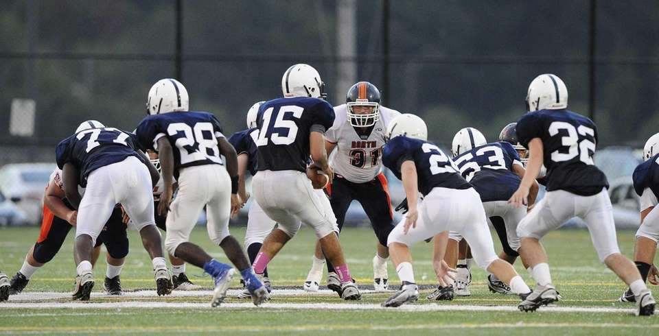 Great Neck North's Oliver Elihu looks to defend