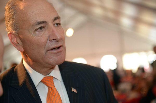 U.S. Sen. Charles Schumer speaks with people during