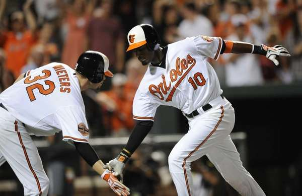 Baltimore Orioles outfielder Adam Jones celebrates his home