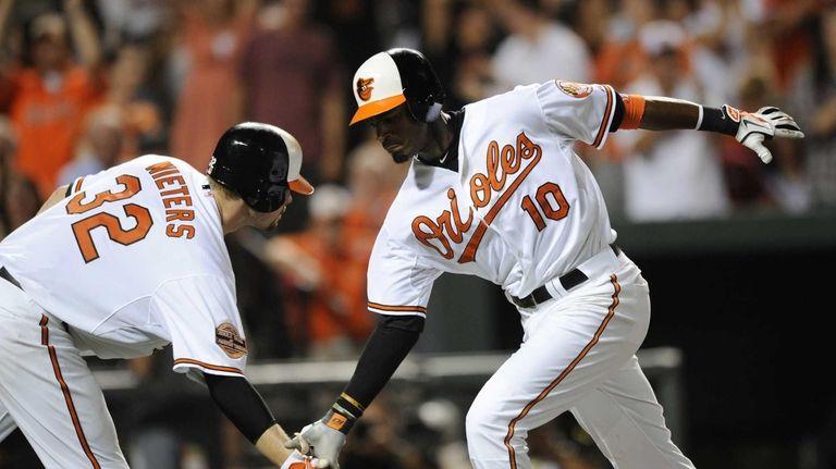 Baltimore Orioles outfielder Adam Jones celebrates his home