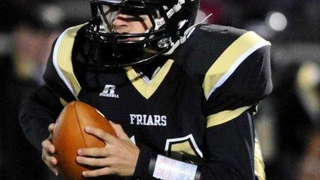 St. Anthony's High School quarterback Greg Galligan rolls