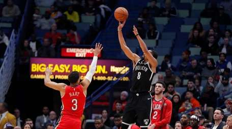Nets guard Spencer Dinwiddie (8) attempts a 3-point