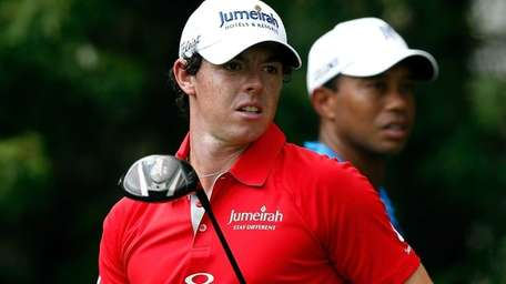 Rory McIlroy and Tiger Woods wait on the