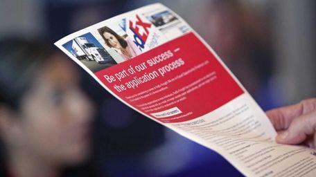 A job seeker reads FedEx Corp. employment information