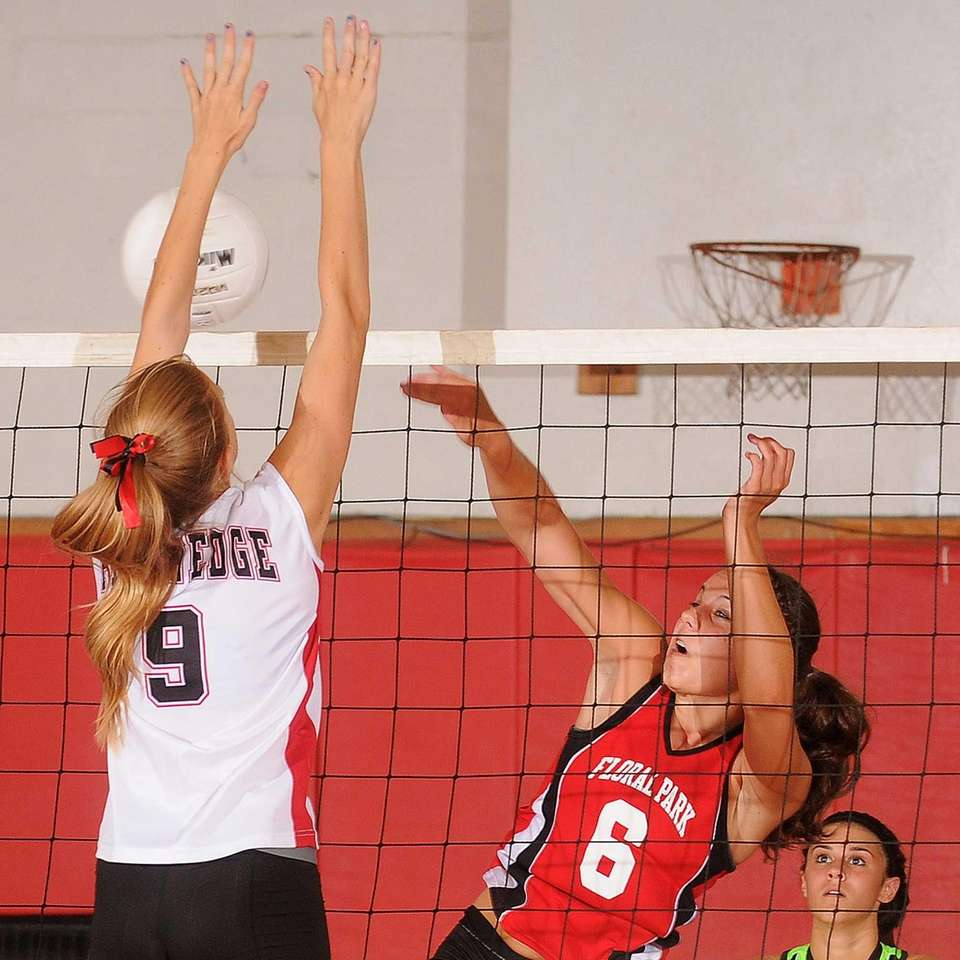 Floral Park senior Samantha Anderson, right, attempts to
