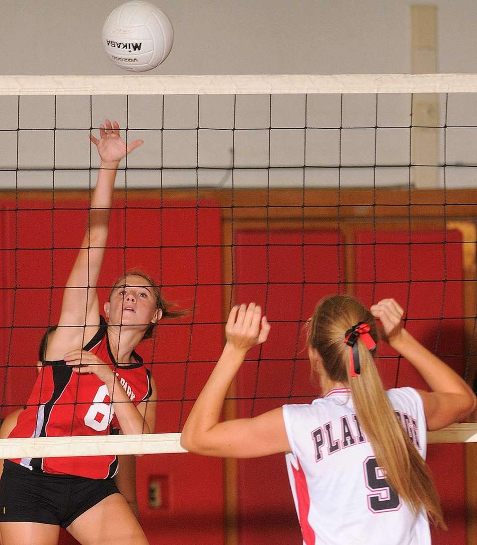 Floral Park senior Jenna Colasante, left, hits over