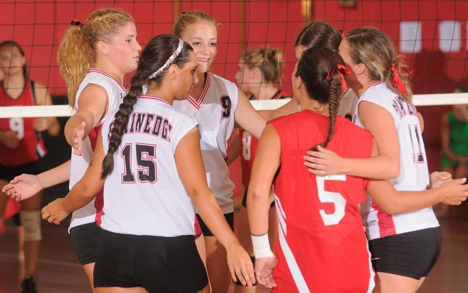 Plainedge High School teammates celebrate a point as