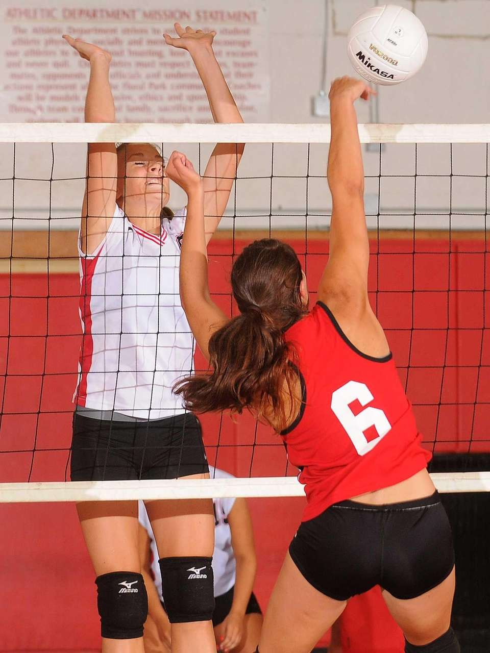 Plainedge's Lisa Maybie, left, defends at the net