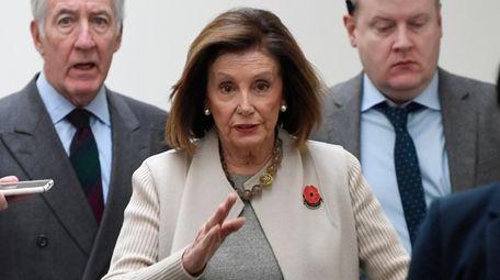 House Speaker Nancy Pelosi of Calif., center, walks