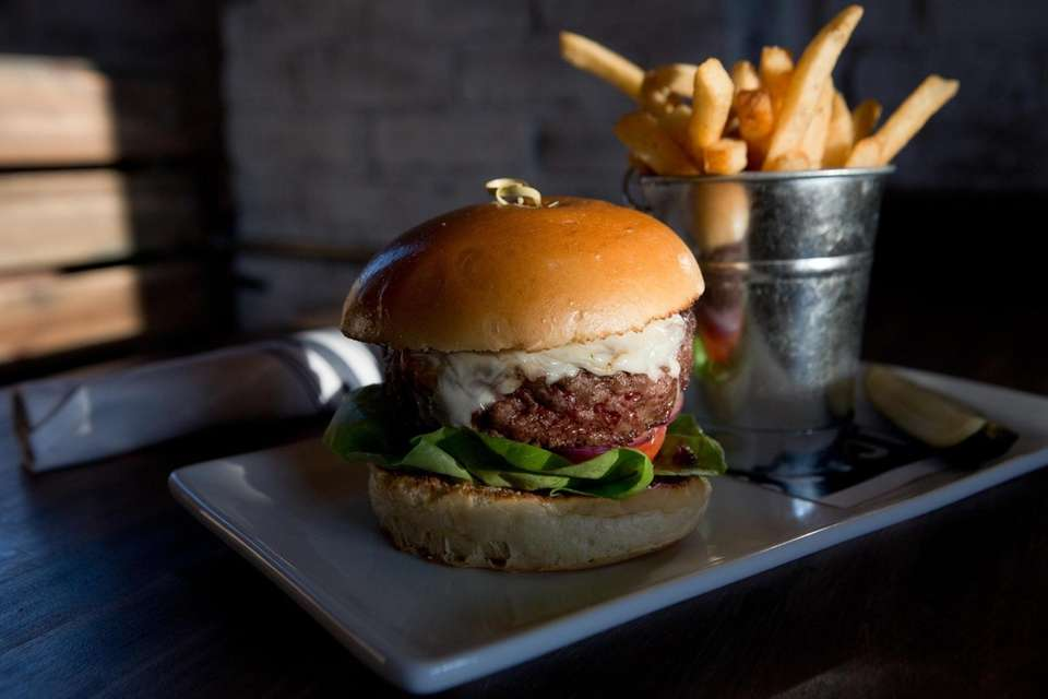 The eight-ounce Publican Burger comes wedged in a