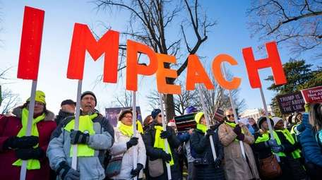 Activists gather at a 'Impeach and Remove' rally
