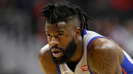Reggie Bullock stands on the court during the