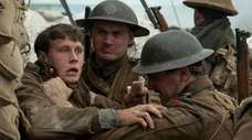 George MacKay, left, plays a soldier sent across