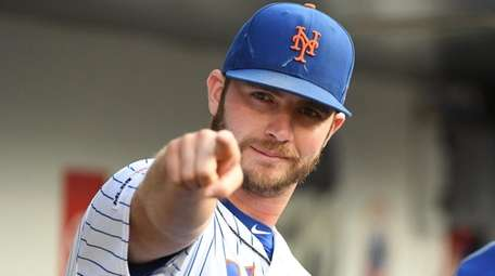 The Mets' Pete Alonso points from the dugout