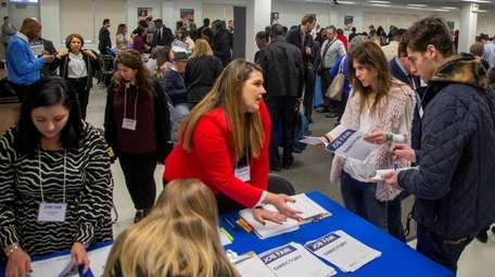 Job applicants attend a job fair last month