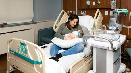New mom Katherine Lewin of Wading River holds