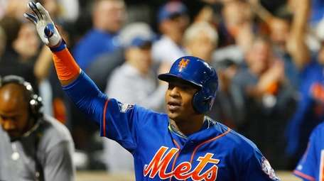 Yoenis Cespedes #52 of the Mets celebrates his