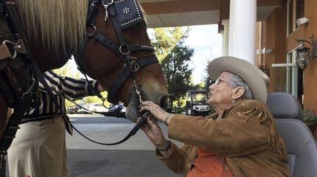 Opal Hagerty, 95, of Escondido meets Blossom, a