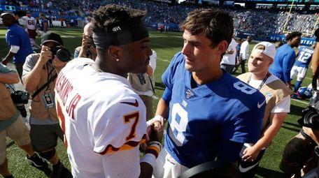 Daniel Jones of the Giants, right, and Dwayne