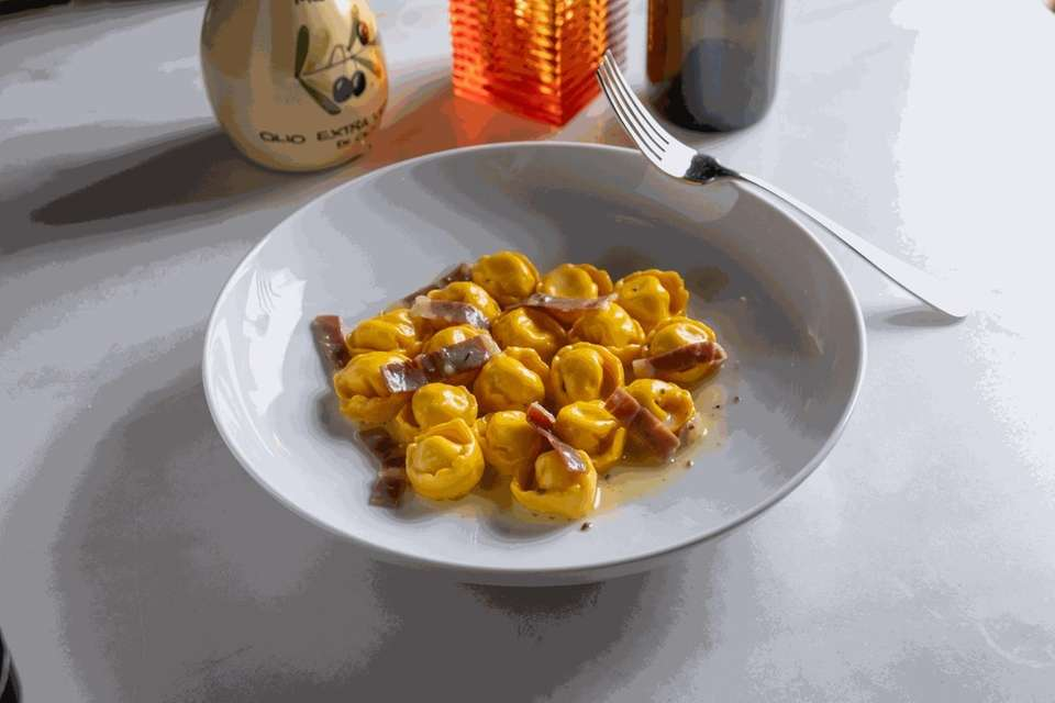 Cappelletti filled with truffled ricotta and dressed with