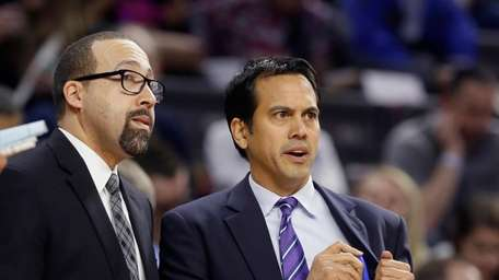 Miami Heat head coach Erik Spoelstra, right, talks