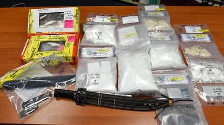 Seized weapons and drugs on display at Friday's