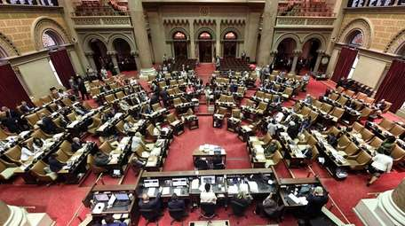 New York state Assembly members work on passing