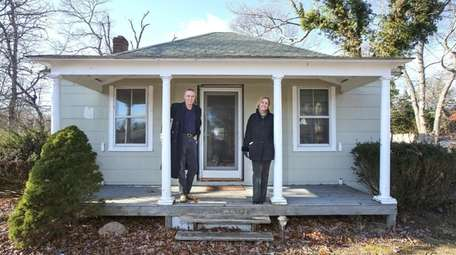 Husband and wife real estate agents Richard and