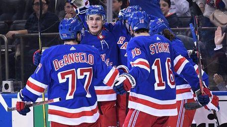 Rangers center Brett Howden is congratulated by teammates