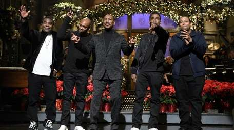 Eddie Murphy, center, is flanked by fellow comedians