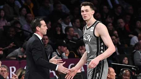 Nets head coach Kenny Atkinson slaps five with
