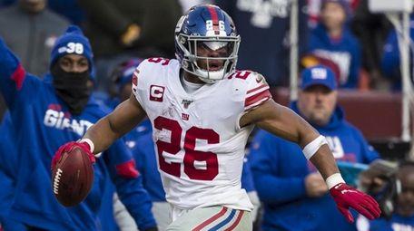 Saquon Barkley of the Giants carries the ball