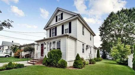 Priced at $550,000, this three-bedroom, two-bathroom Colonial in