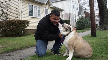 Mauricio Batista of Westbury with his girlfriend's dog,