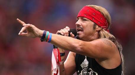 Bret Michaels performs during a half-time show at